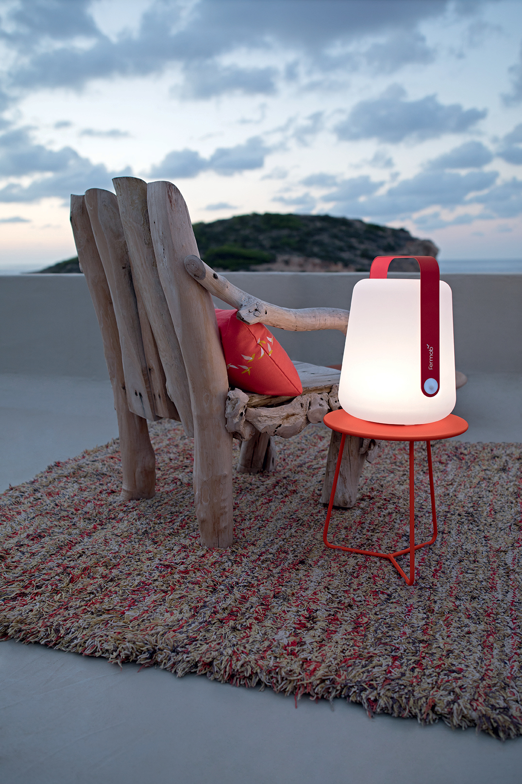 Fermod lamp and chair on the beach